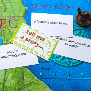 Tell Me a Story game cards lying on a map